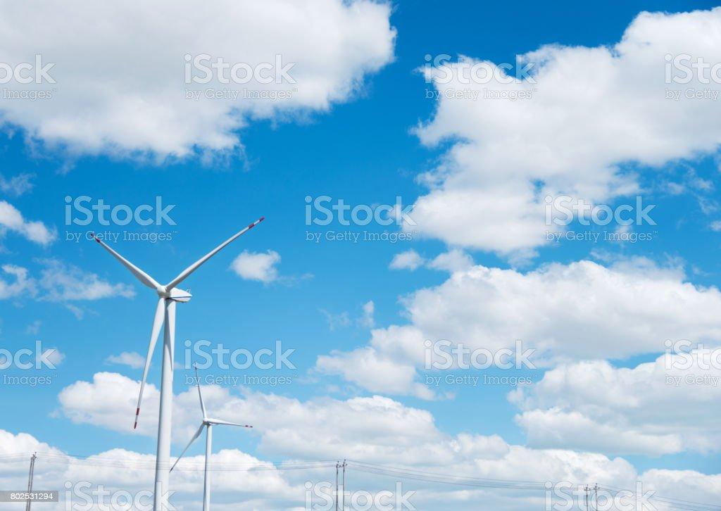 Wind turbine in blue sky stock photo