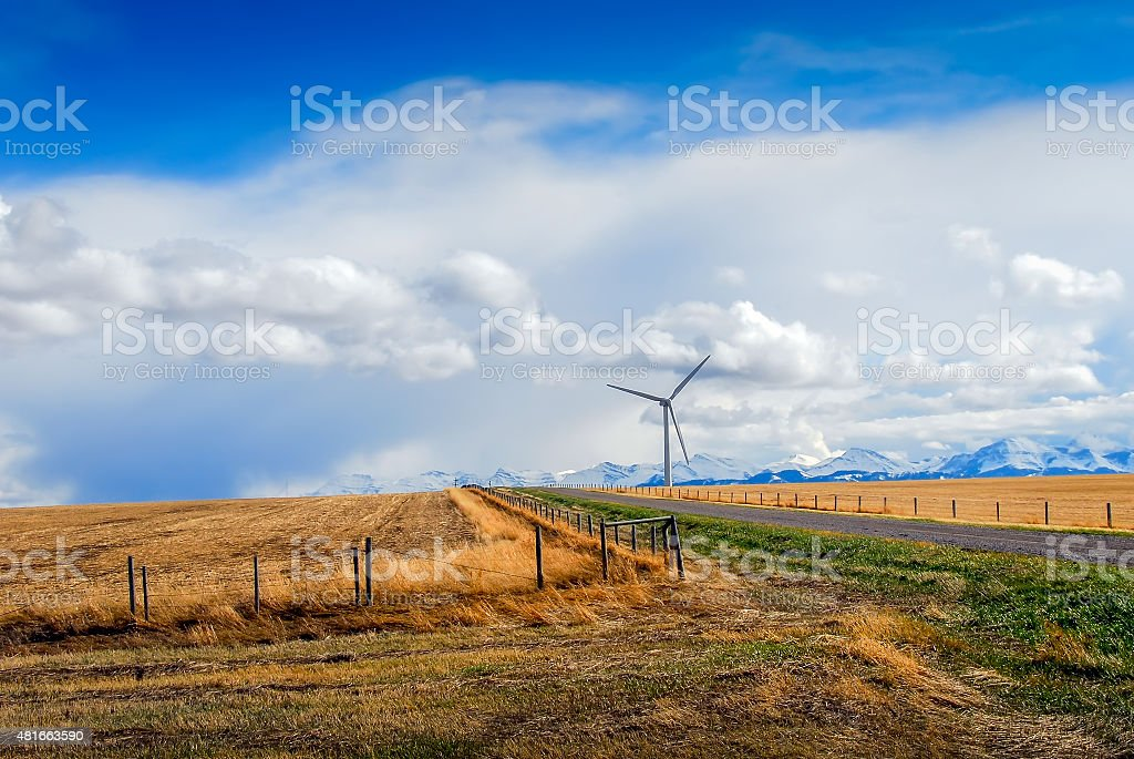 Wind Turbine in Canada with mountains stock photo