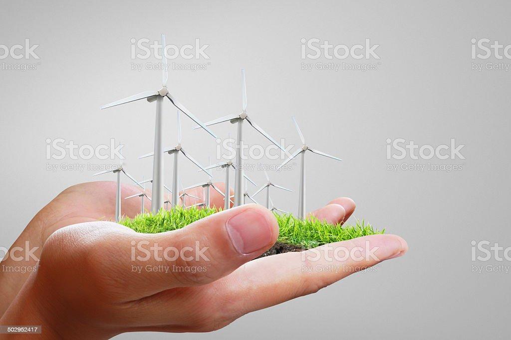 Wind turbine in hand stock photo