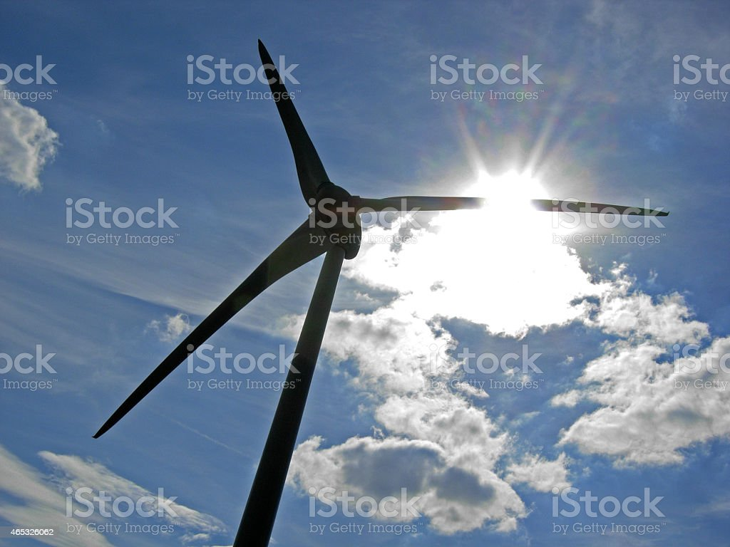 Wind turbine in the back light stock photo