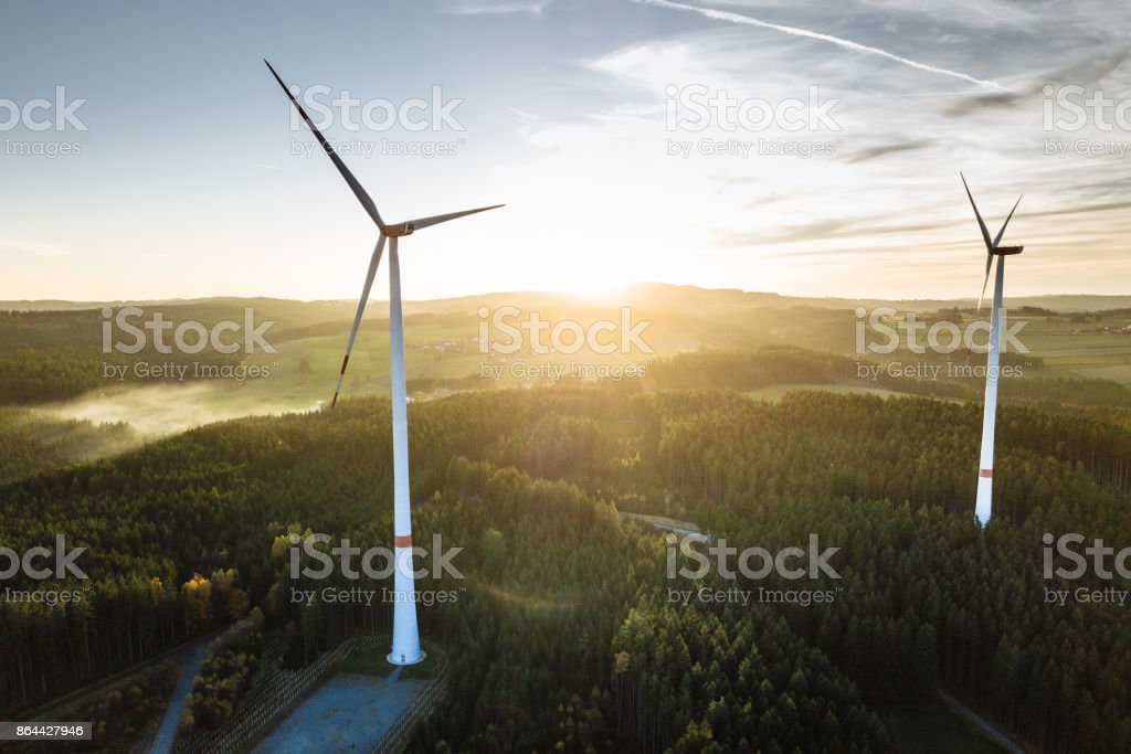 Wind Turbine in the sunset seen from an aerial view stock photo
