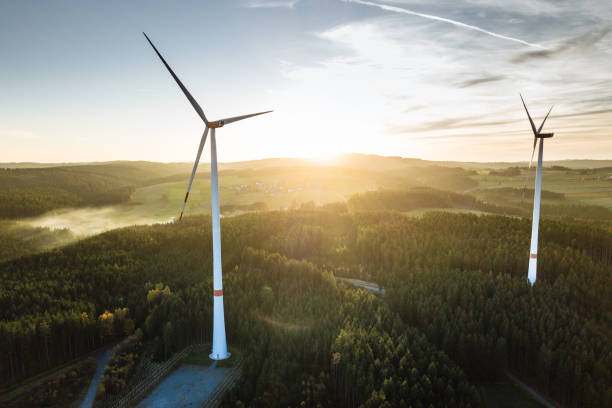 Wind Turbine in the sunset seen from an aerial view Wind Turbine in the sunset seen from an aerial view wind power stock pictures, royalty-free photos & images