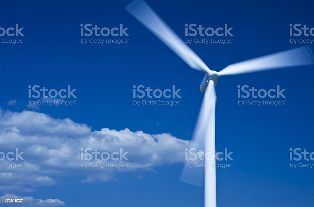 Wind turbine, motion blur and tungsten processed. Copy space. royalty-free stock photo