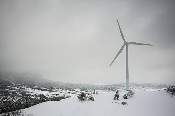 Wind turbine on a snowy mountain. stock photo