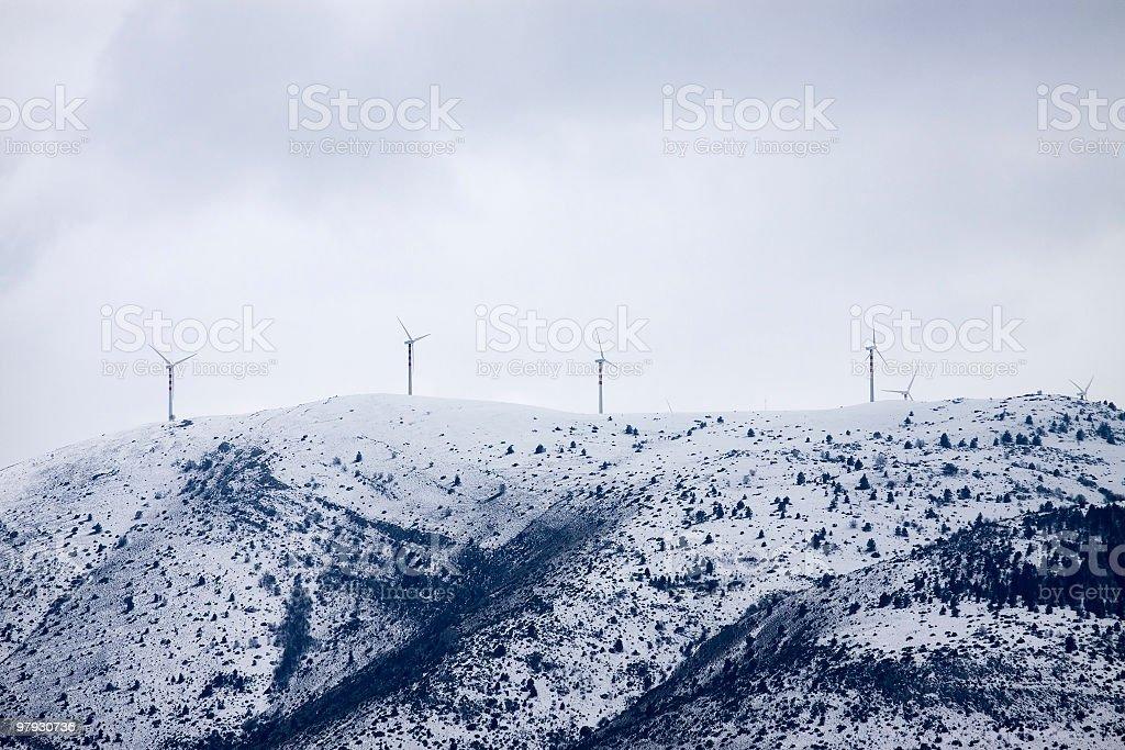 Wind turbine on a snowy mountain royalty-free stock photo