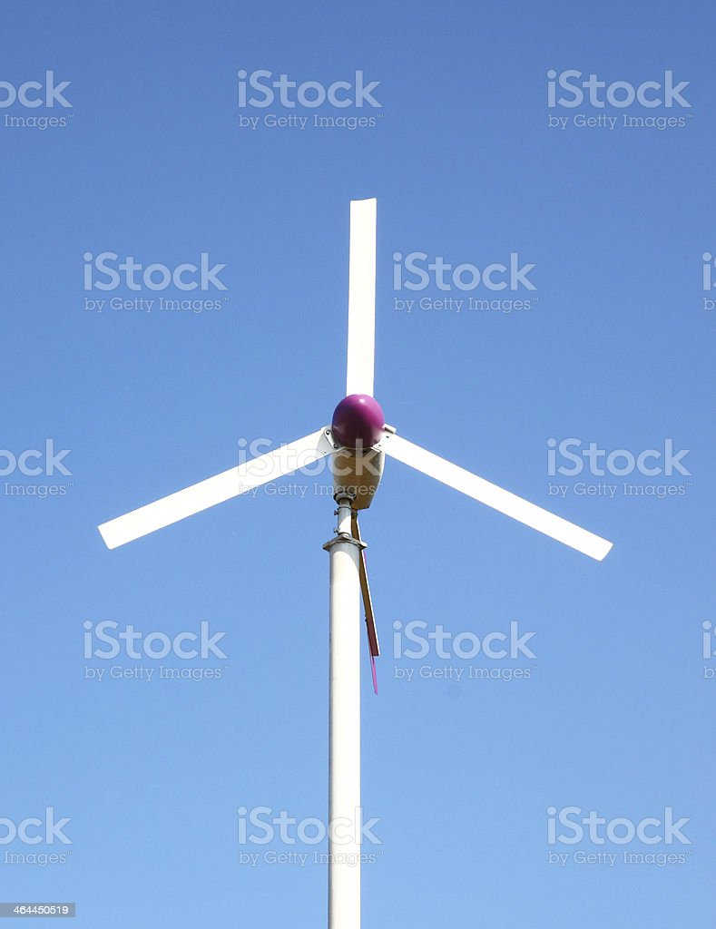 wind turbine on blue sky background royalty-free stock photo