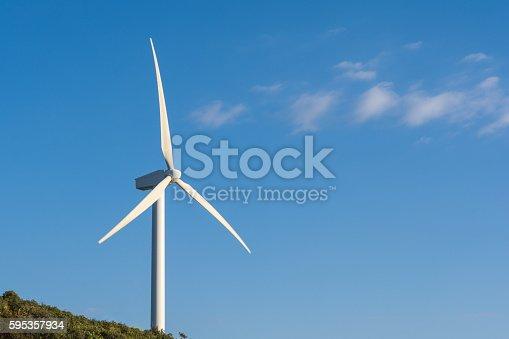 istock Wind turbine on blue sky 595357934