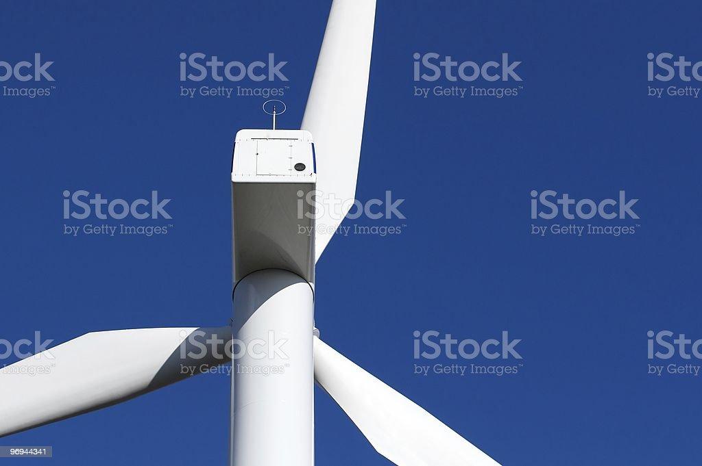 Wind turbine on blue sky royalty-free stock photo