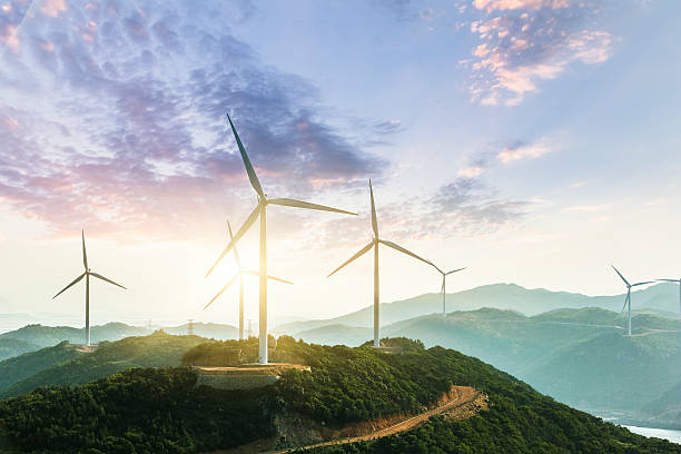 Wind Turbine Wind Turbine sin sunset, china. windmill stock pictures, royalty-free photos & images