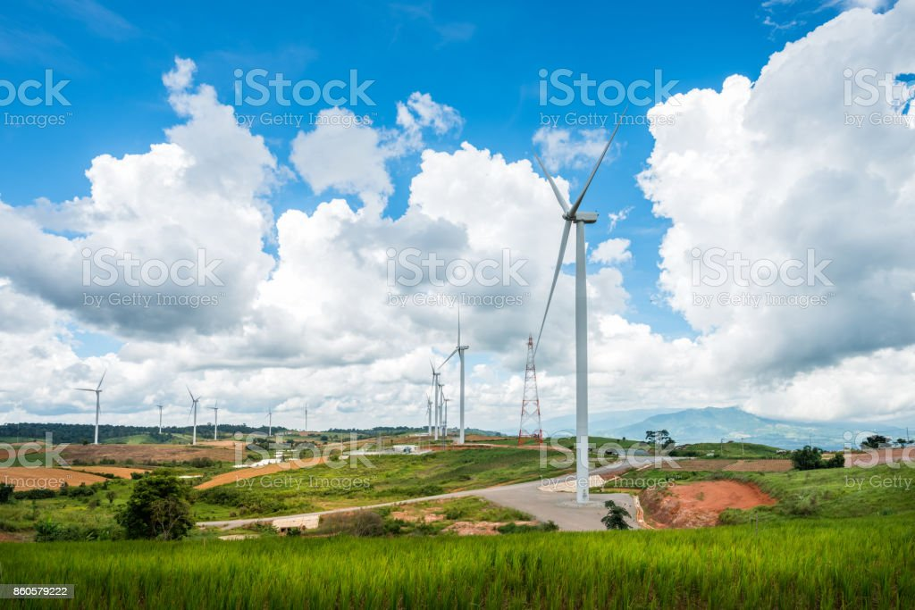 Wind turbine power generators on mountain stock photo