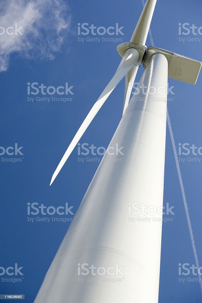 wind turbine power station from below against a blue sky royalty-free stock photo