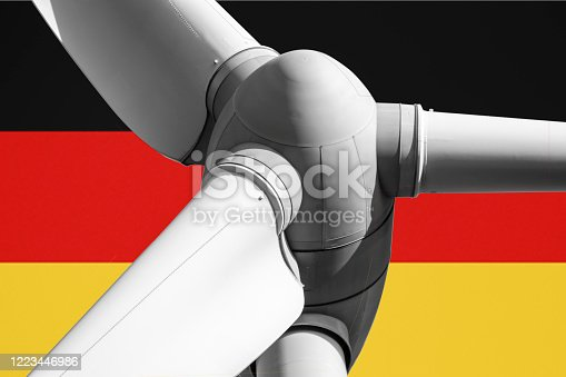 Wind turbine rotor with Germany flag in the background. Alternative renewable energy in Germany