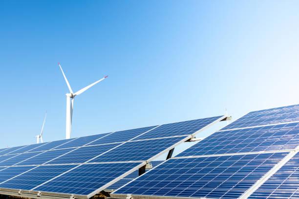 Wind turbine solar panel renewable energy stock photo