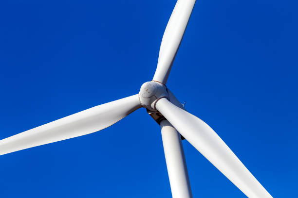 Wind turbine spinning for renewable electricity production stock photo
