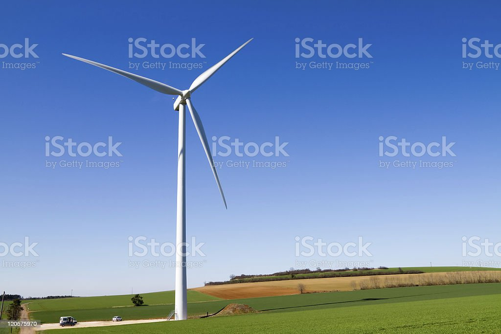 Wind turbine under clear blue sky royalty-free stock photo