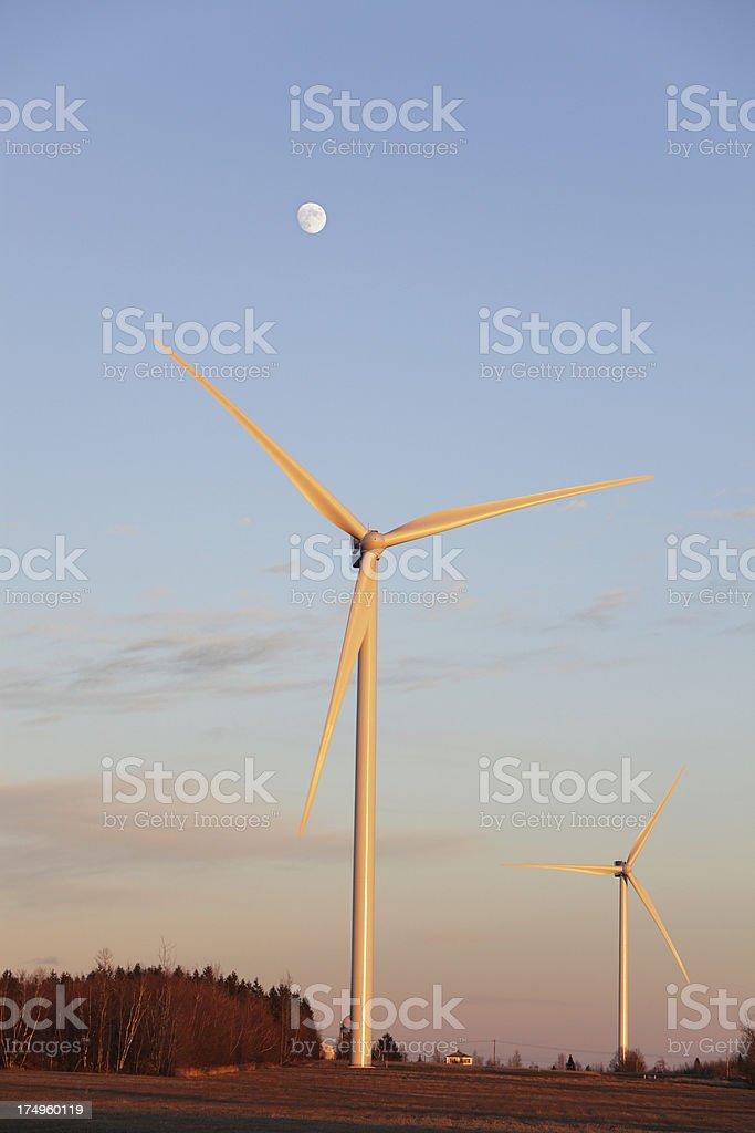 Wind Turbine Windmills Under Sunset Moon royalty-free stock photo
