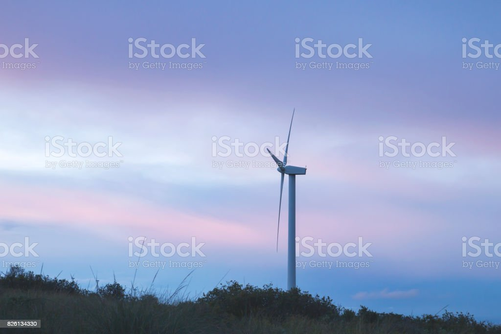 wind turbine with beautiful sunset colorful stormy clouds stock photo