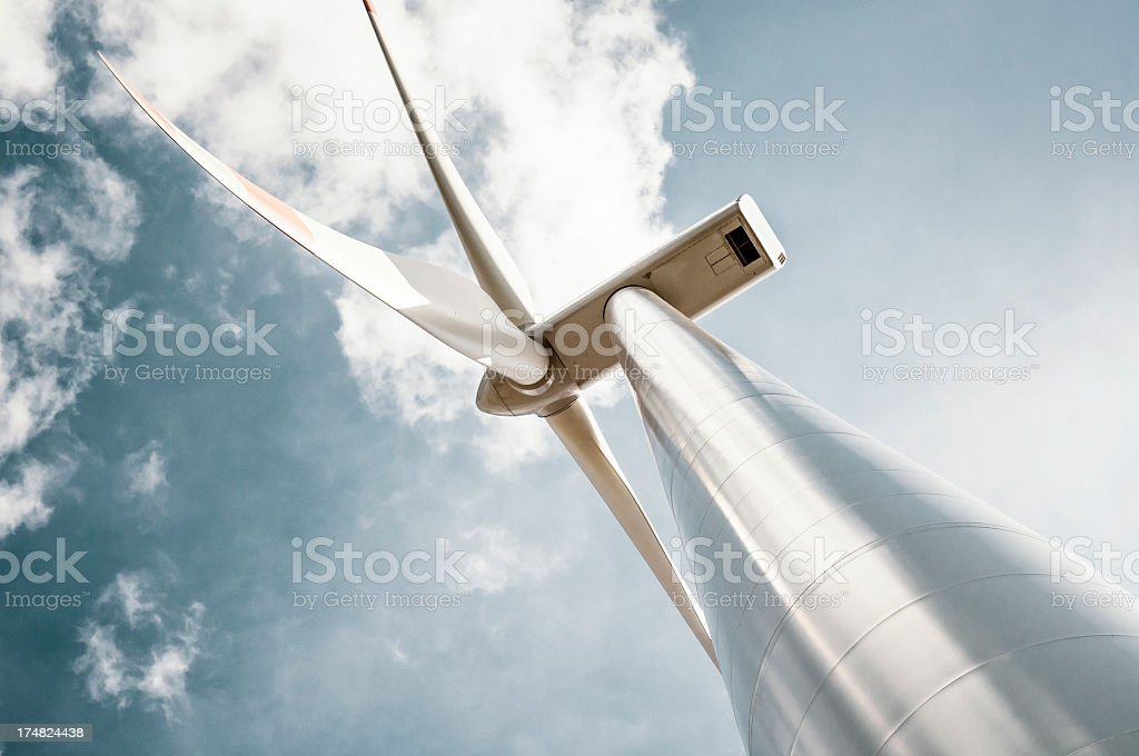 Wind turbine with blue gray sky stock photo