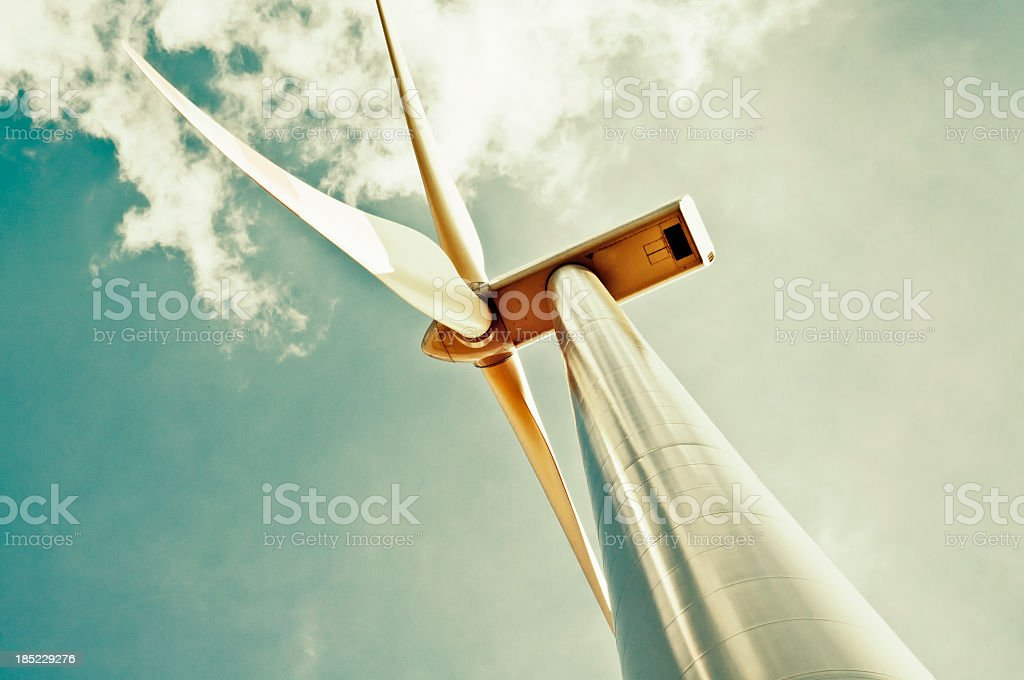 Wind turbine with green sky stock photo