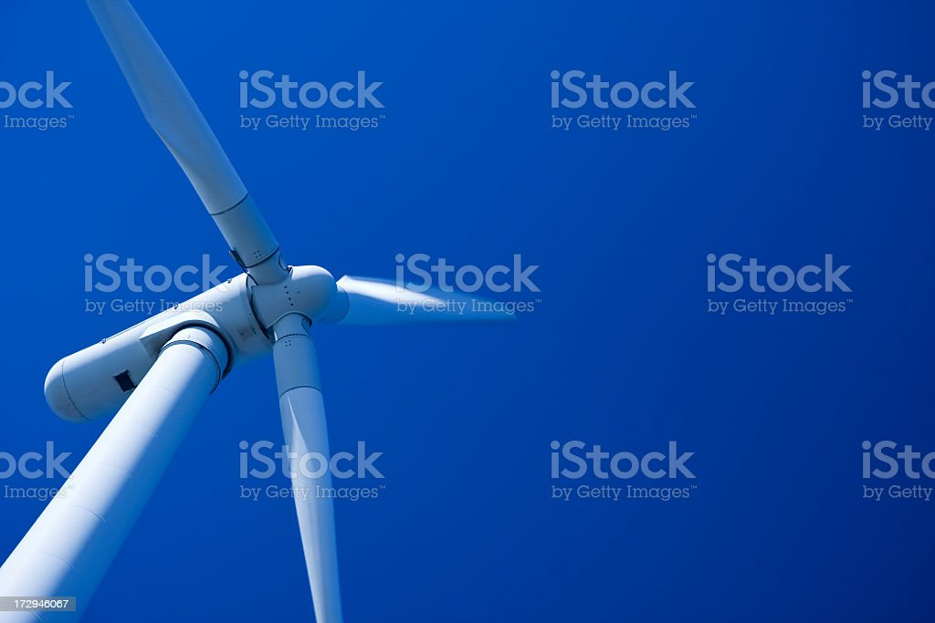 A wind turbine with the blue sky on the background royalty-free stock photo
