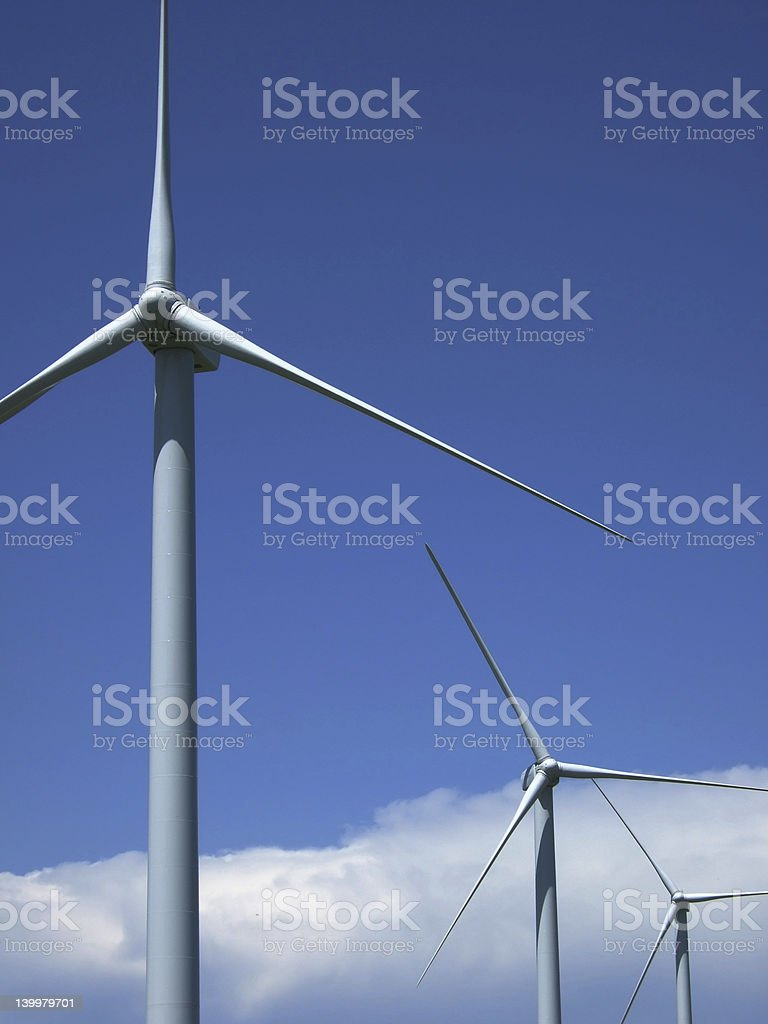 Wind turbines against prairie sky and thunderstorm royalty-free stock photo
