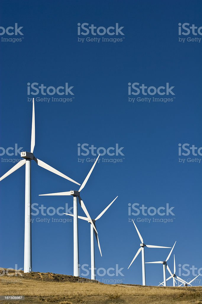 Wind turbines along a barren field royalty-free stock photo