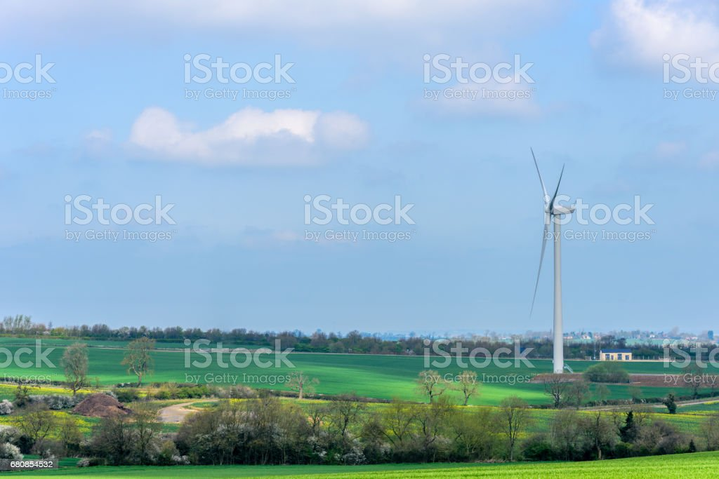 Wind Turbines and Blue Sky with Clouds over UK fields stock photo