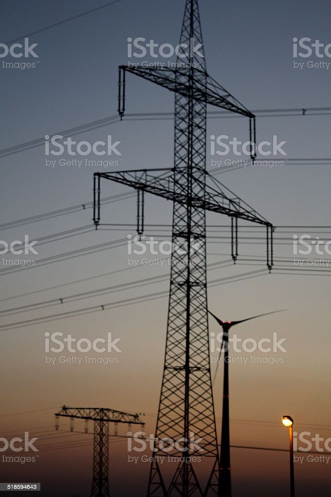 wind turbines and eletricity highways stock photo