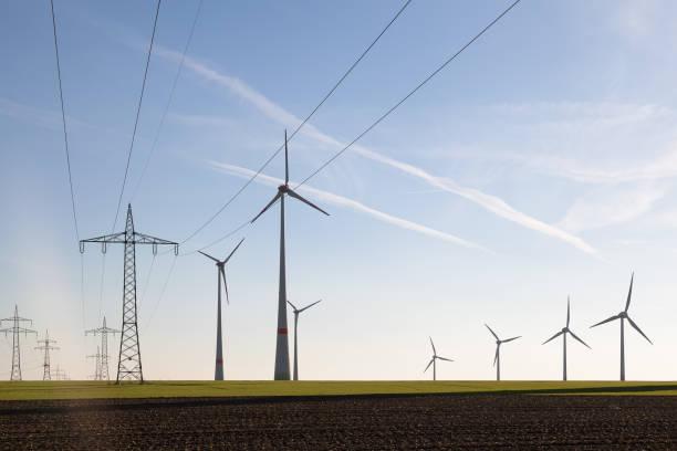 wind turbines and high voltage transmission lines in a huge wind farm - weißenfels stock-fotos und bilder