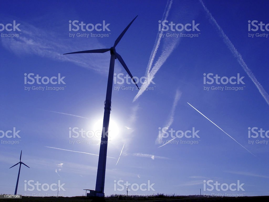 Wind Turbines and Plane Trails royalty-free stock photo