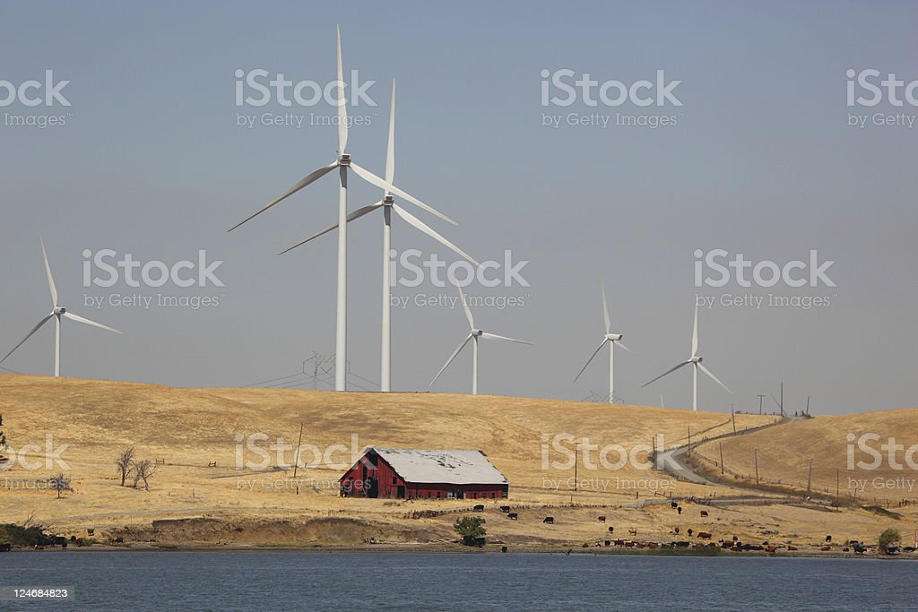 Wind Turbines and Power Lines stock photo