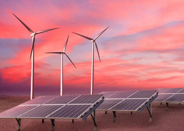 Wind turbines and solar panels as alternative renewable energy. stock photo