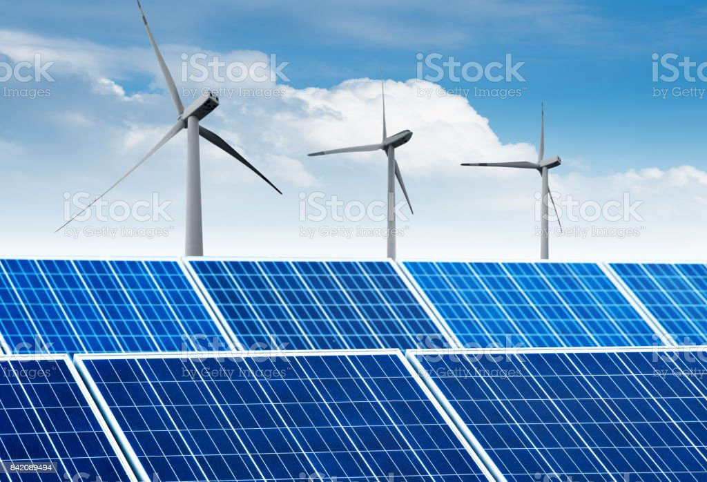 Wind turbines and solar panels. Green energy stock photo