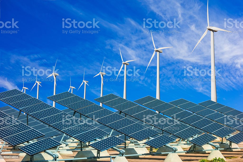 Wind turbines and solar panels making green energy stock photo