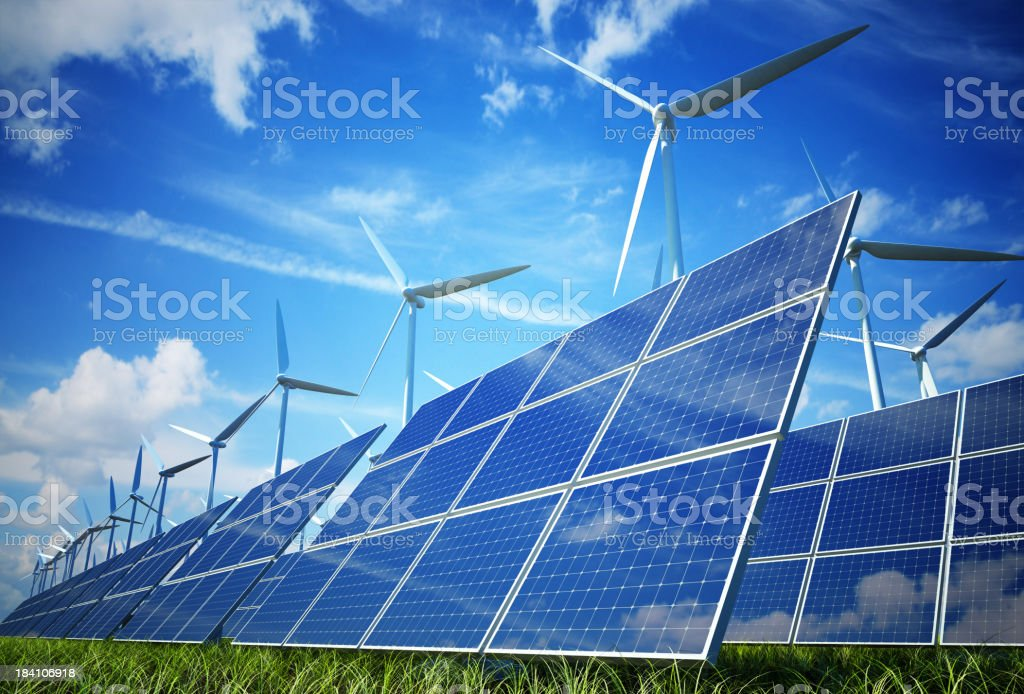 Wind turbines and solar plates making green energy stock photo