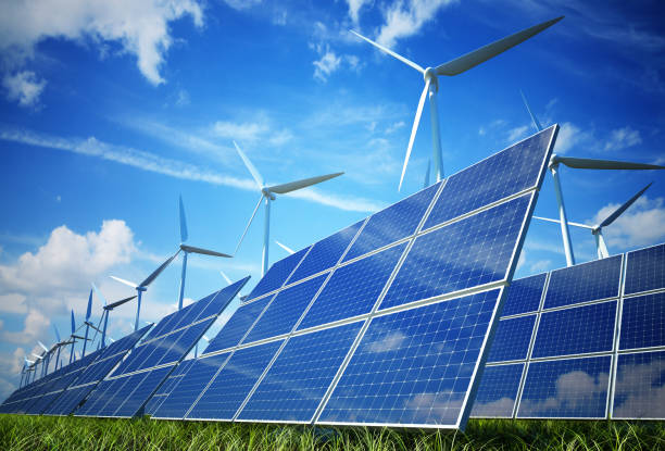 Wind turbines and solar plates making green energy Green Energy solar panels photos stock pictures, royalty-free photos & images