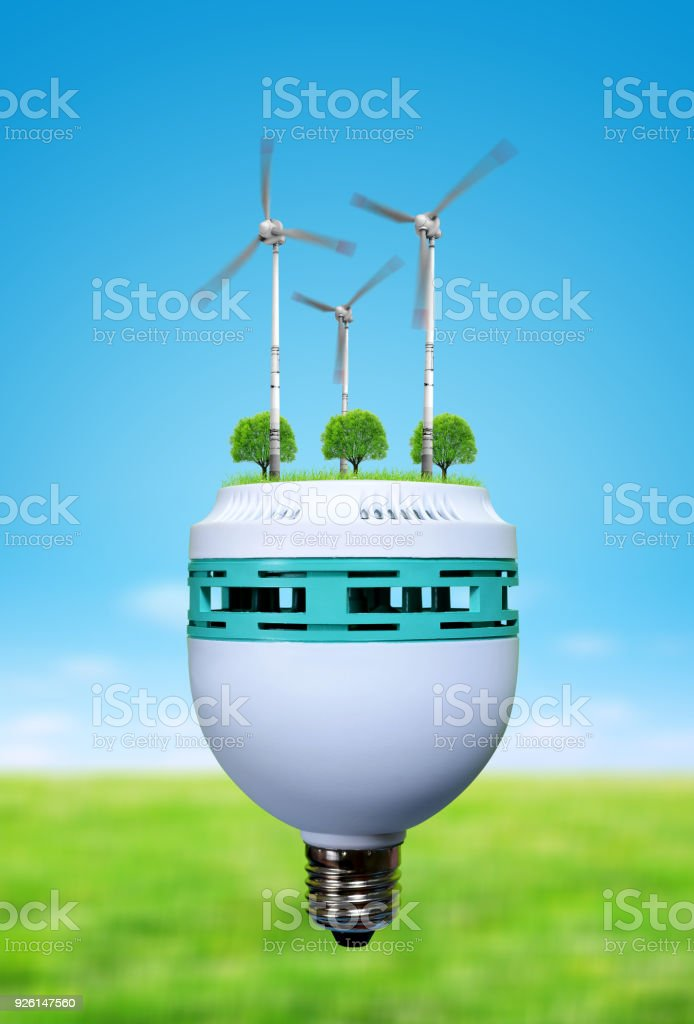 Wind turbines and trees in bulb. Saving lamp. stock photo