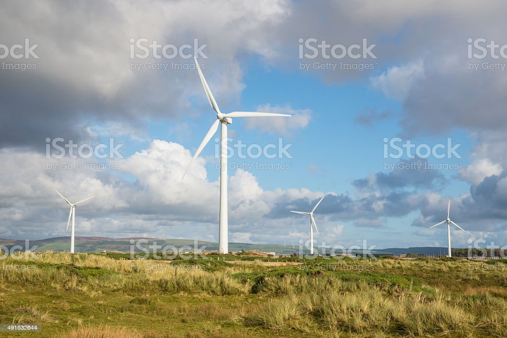 Wind turbines are part of the landscape. stock photo