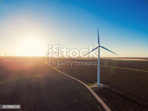 892160114 istock photo Wind turbines at sunrise 532880200