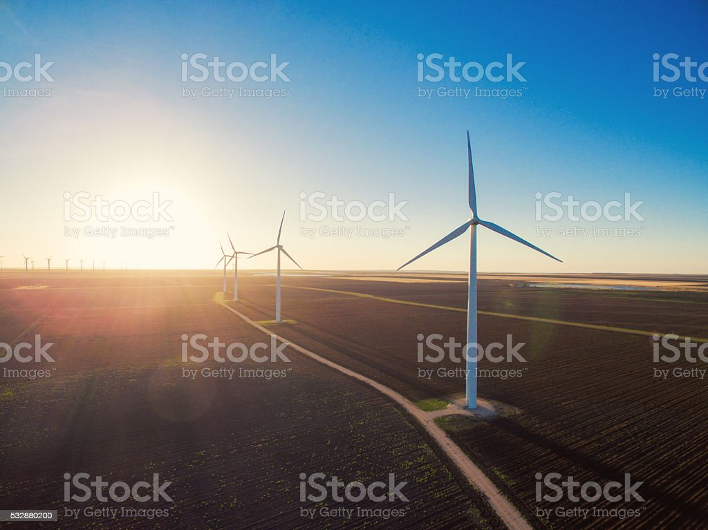 Wind turbines at sunrise stock photo