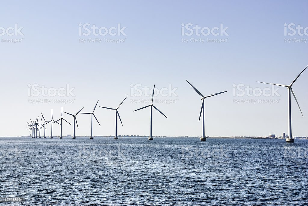 Wind turbines at the ocean royalty-free stock photo