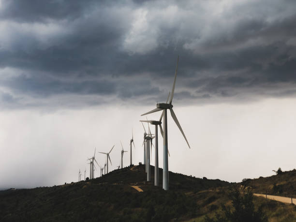 Wind turbines during a storm. stock photo