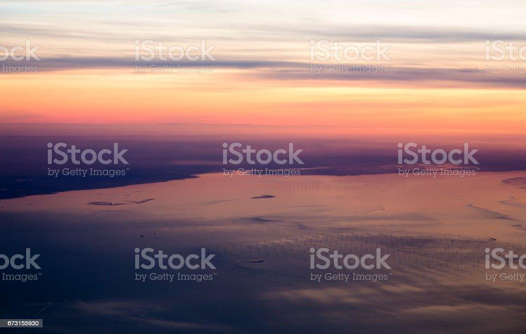 Wind turbines farm on North Sea at English coast view from sky stock photo
