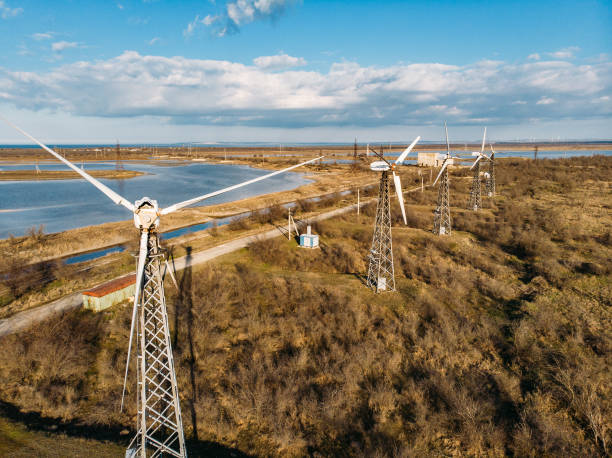 Wind turbines for generating alternative renewable electricity, eco technology innovation for environment protection stock photo