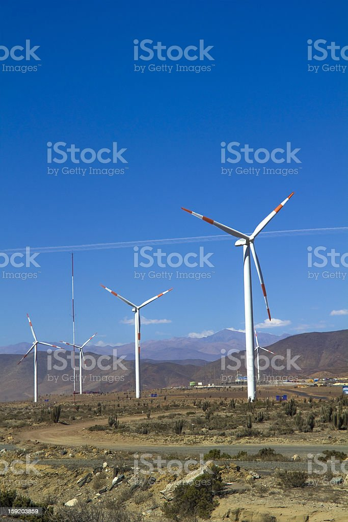 Wind turbines generating electricity stock photo