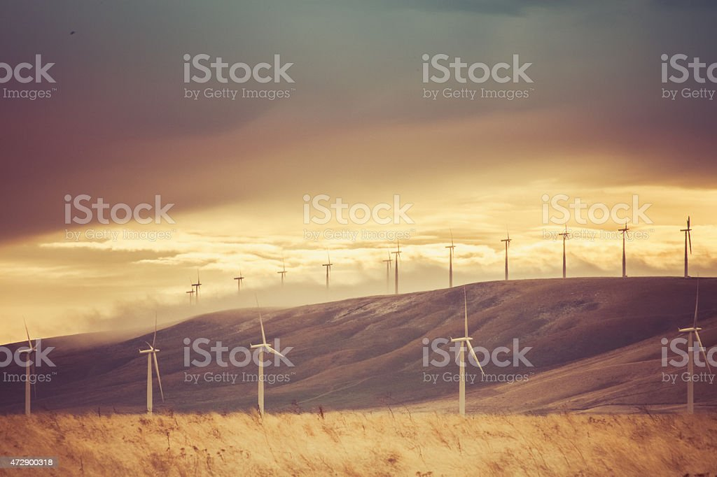 Wind turbines, hills and sky - Nature landscape stock photo
