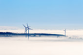 Wind turbines in a foggy landscape