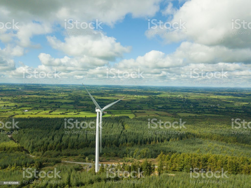 Wind turbines in a forest stock photo