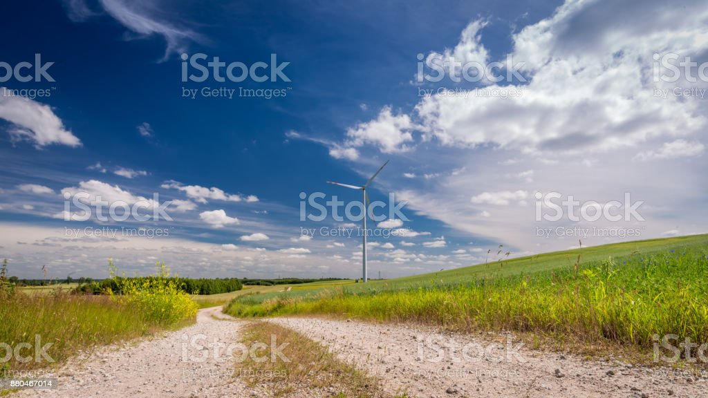 Wind turbines in a meadow as alternative energy in summer stock photo