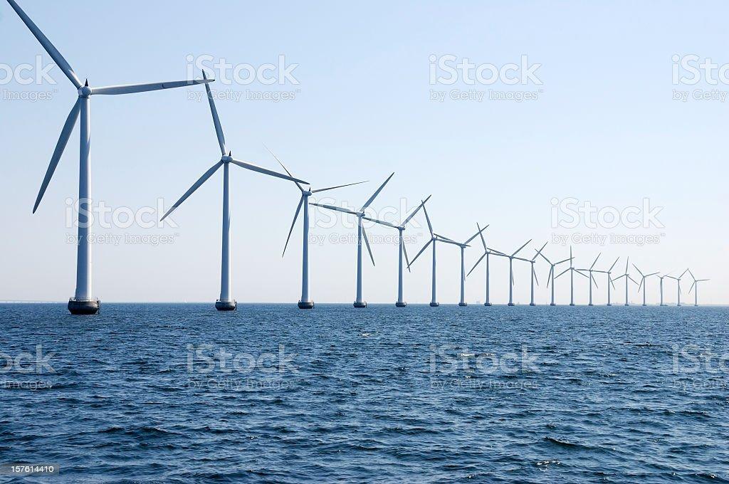 wind turbines in a row at sea outside Copenhagen stock photo